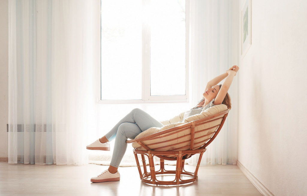 person resting in a comfy chair