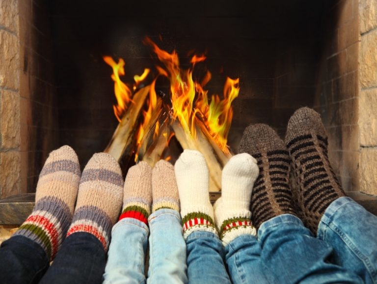 keeping feet warm by the fireplace