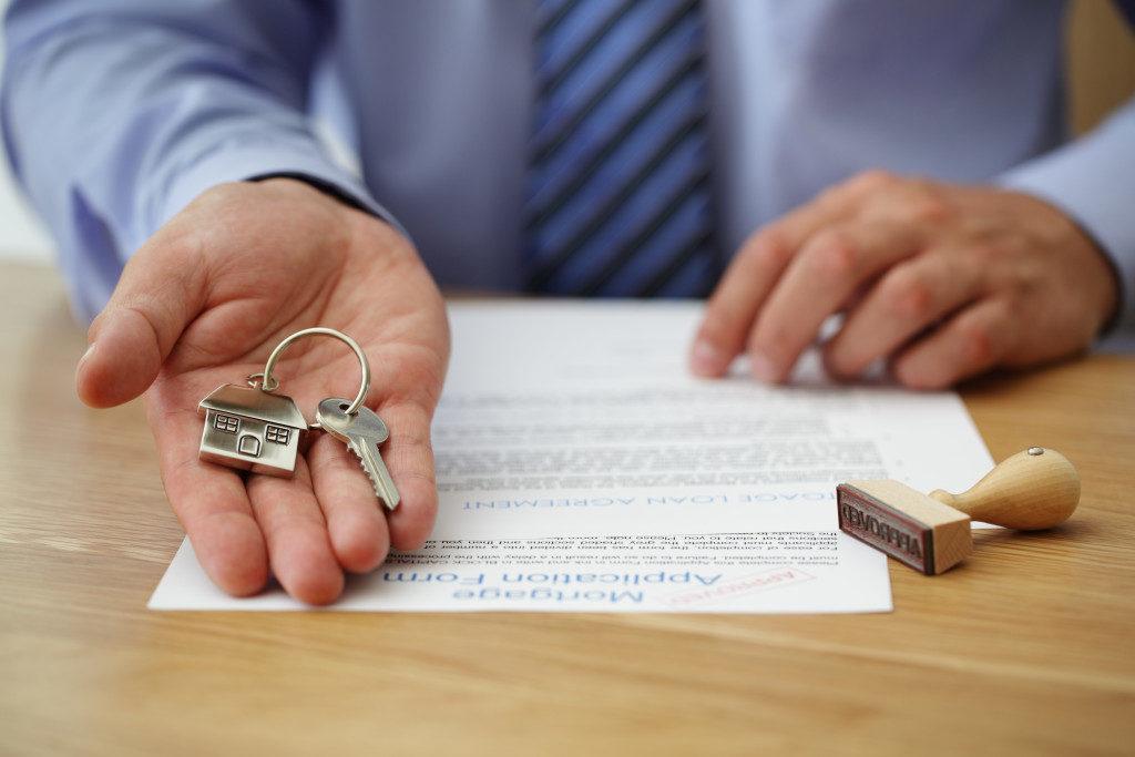 broker handing a home key