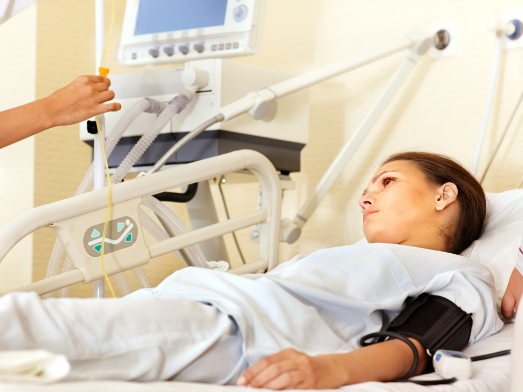 Female patient lying on hospital bed