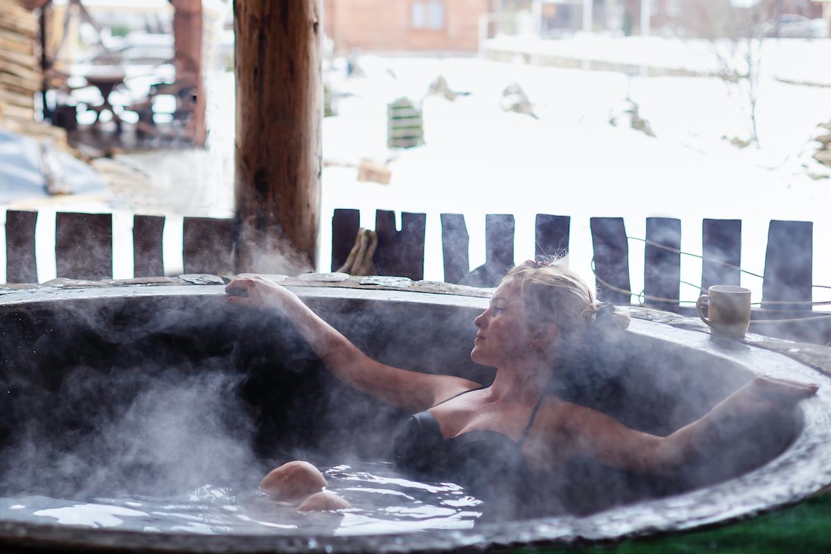 woman having a hot bath outside