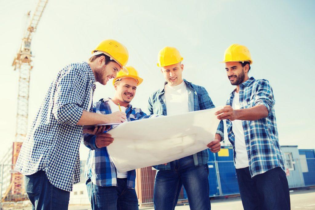 Contractors looking at a blueprint