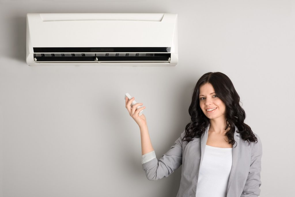 Woman and air conditioner