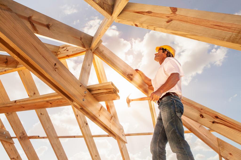 man creating roof