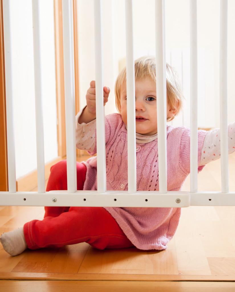 baby behind stair gate